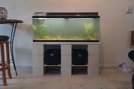 tank furniture. DIY Fish Aquarium Stands Made From Nine Painted Cinder Blocks With Open Shelf Underneath On Cream Carpet Flooring Tank Furniture