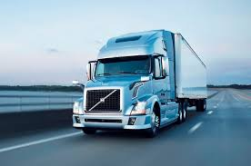 volvo trucks 2014 wallpaper. 2014 volvo vnl 670 driving trucks wallpaper