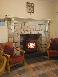 Classy White Stones Wall Panels Around Mantel Fireplace Ideas Added Wooden  Arm Chairs As Formal Living Room Decors