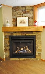 unique corner stone veneer fireplace with thick wood mantel and decorative red lantern