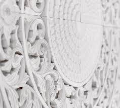 white wooden medallion wall art