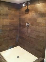 Small Picture Faux wood plank shower wall tile and pebble shower floor tile
