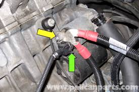 bmw e starter replacement e e e pelican parts diy working at back of starter remove 13mm battery positive cable nut