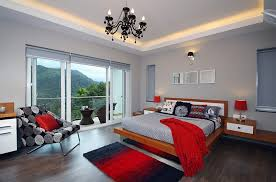 exquisite use of red accents in the cheerful gray bedroom design savio rupa
