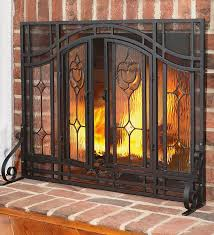 small two door fl fireplace screen with beveled glass panels and tool set