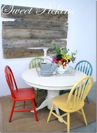 My freshly painted dining table with different coloured chairs & a  whitewash affect