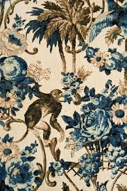 this fabric has an elegant teal and taupe fl animal print suitable for soft furnishings and curtains