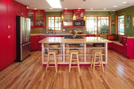 red cabinets bookshelves colorful kitchen cookbook storage glass cabinets green wall kitchen island kitchen island storage