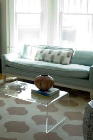 Pretty living room with Madeline Weinrib rug and CB2 acrylic coffee table