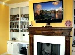 how to mount tv over fireplace lower above hide wires mantelmount