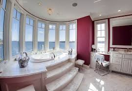 traditional master bathroom with step up bathtub with ocean views