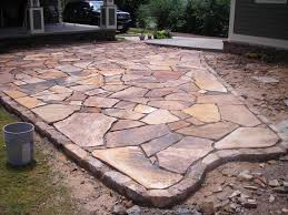 flagstone patio pictures designs. stacked stone garden edging | brown flagstone patio with moss rock border- under construction pictures designs
