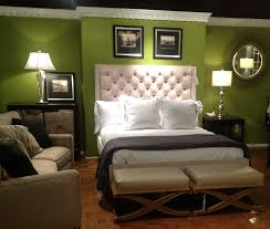 bedroom captivating green master bedroom decor with white tufted haedboard and cream sofa sets also sunburst wall mirror coolest green bedroom colors
