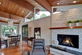 stacked stone fireplace with wood mantle living room transitional with wood mantel open floor plan my