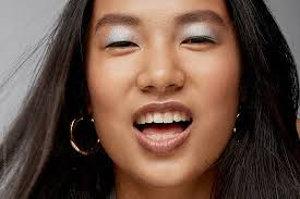 new beauty beautiful young asian woman makeup portrait in studio by leandro crespi for stocksy