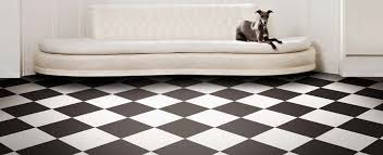 black and white checkerboard floor in a hallway