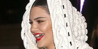 kendall jenner steps out in london sporting 2 gold tooth