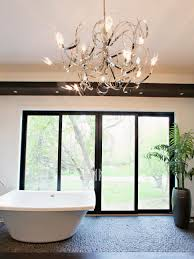 unique bathroom lighting fixtures. bathroomsstylish bathroom with small bathtub near glass windows under unique modern chandelier lighting fixtures