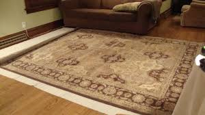 i wanted to do as little cutting as possible so i laid 2 sides of the rug right where they needed to be with the corner of the rug going just
