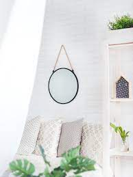 how to hang a mirror on a wall without
