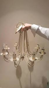 cream coloured metal chandelier in great condition
