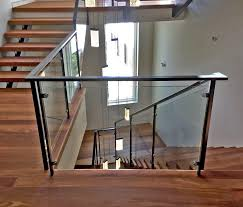interior glass handrail system on winding staircase