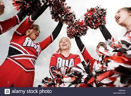 Cheerleaders with pom poms - Stock Image Cheerleader Pom Poms Photos \u0026