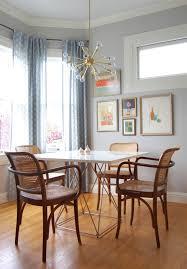 a mid century modern sputnik chandelier hangs over a table large sputnik chandelier over dining room table