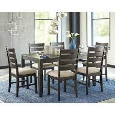 ashley dining room table set. signature design by ashley rokane brown 7-piece dining room table set