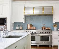 soft blue hue glass tile backsplash