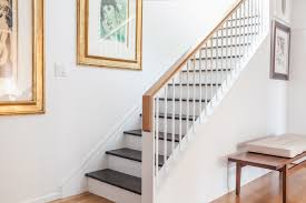 Wood Tone Handrail With Black Treads Stairway Color Accent. Decorative  Staircase As Dramatic