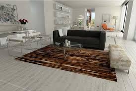 cowhide rug brown patchwork cowhide rug designed in stripes in a white and modern living room cowhide rug