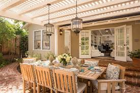 rustic lanterns complete a beautiful and inviting outdoor dining space design abbott moon