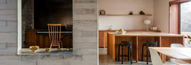 the bination of smooth poured concrete floors and rough grey brick and blockwork walls