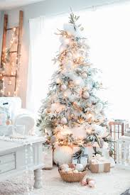 We've compiled a gallery of flocked Christmas tree decoration ideas for you  below.