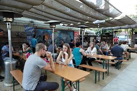 sacramento s first bar made from containers staying true to authentic german beer gardens all outdoors with long tables made for drinking with