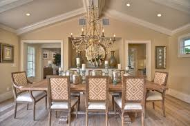 vaulted crown moulding dining room beach style with vaulted ceiling contemporary chandeliers