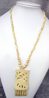 antique carved ivory necklace with elephant pendant
