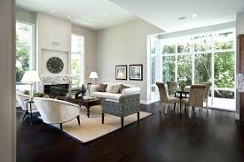 best rug pad for hardwood floors family room contemporary with area beige wall image by mark architects charming pads hardwoo