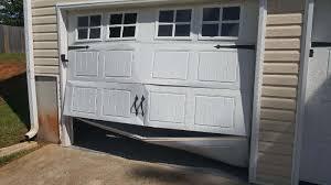 damaged garage door replacement peachtree city ga