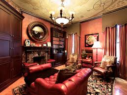 home library lighting. Traditional Home Library Design With Dark Brown Varnished Mahogany Wood Cupboard And Marble Granite Fireplace Under Round Framed Wall Mirror As Well Lighting