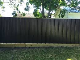 image of corrugated steel fence panels