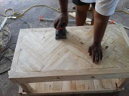You can keep the wood natural, as shown, or stain and paint it to match your decor. Pallet Chevron Coffee Table Diy Tutorial