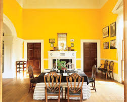 Monticello dining room after picture A coat of striking dandelion yellow  paint opens the room and