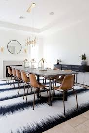dining room with leather dining chairs and tye dye black and white rug