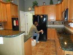 medium oak kitchen cabinets. VERDE PEACOCK Great With Medium Wood Kitchen Cabinets Traditional-kitchen Oak