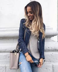 wear a navy leather motorcycle jacket with jeans to be both cool and relaxed so