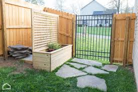 garden box covered in en wire you can see in the photo below that we moved trash cans to location wanted put unfinished diy fence