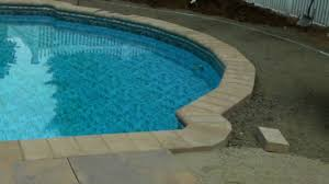 tile over concrete pool deck bullnose coping and ribbon stone pool patio you