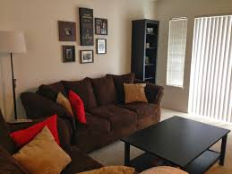 image of living room ideas with dark brown couches